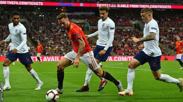 Spain midfielder Saul Niguez vies with England's defender Joe Gomez (left), England's midfielder Dele Alli (centre) and England's defender Kieran Trippier (right)