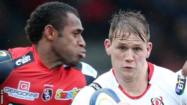 Oyonnax's Uwa Tawalo moves in to challenge Ulster winger Craig Gilroy
