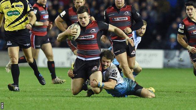 Matt Scott is tackled by Peter Horne