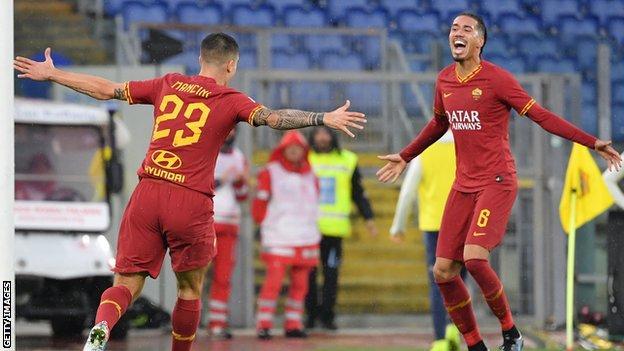 Chris Smalling celebrates with Gianluca Mancini