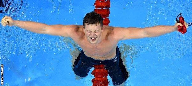 Adam Peaty celebrates Olympic gold