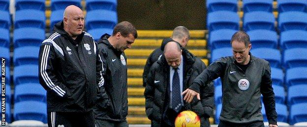 Cardiff City manager Russell Slade and match officials before kick-off