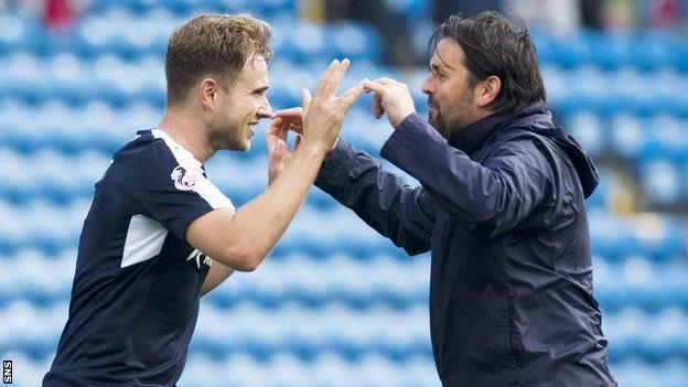 Paul Hartley (right) led his side to the top of the table with a 4-0 win at Kilmarnock