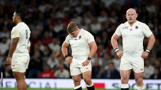 England's players look dejected at the end of the match