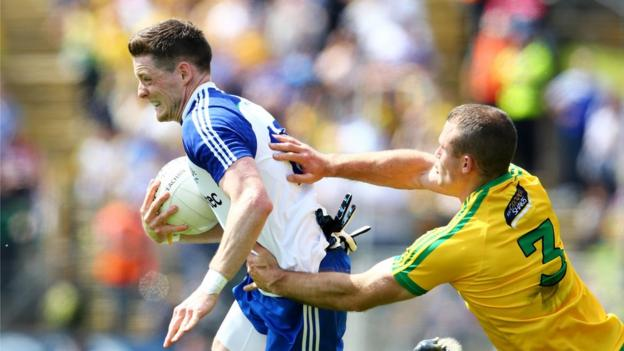 Conor McManus makes ground for Monaghan as Neil McGee tries to halt him in his tracks