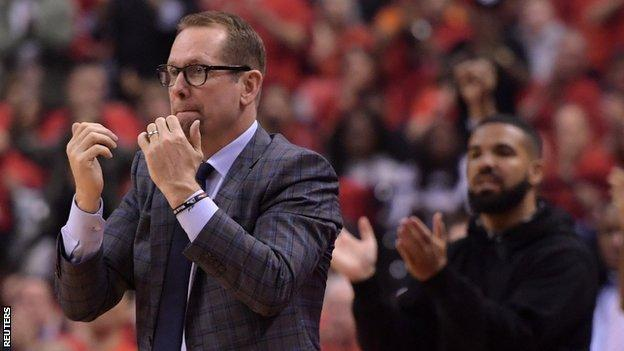 Toronto Raptors coach Nick Nurse with Raptors ambassador and fan, music star Drake, looking on