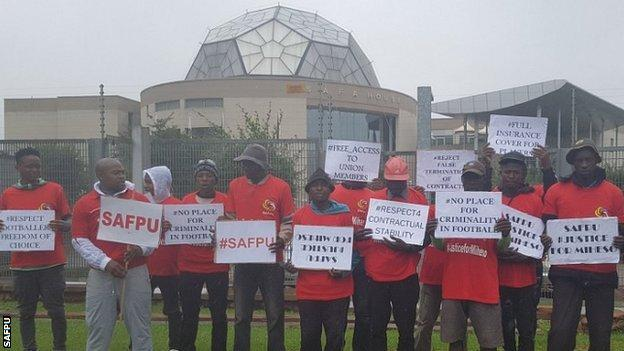 Local players protest outside Safa headquarters on the day of Infantino's visit