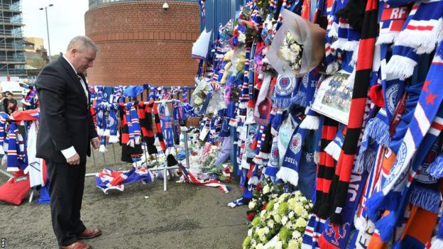 Rangers manager Ally McCoist lays a wreath in memory of club favourite Sandy Jardine