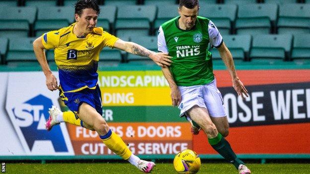 St Johnstone's Danny McNamara and Hibs' Jamie Murphy