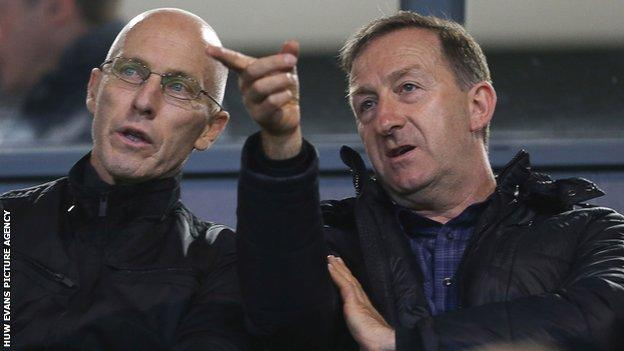 New Swansea City manager Bob Bradley with club chairman Huw Jenkins at an under-23 match
