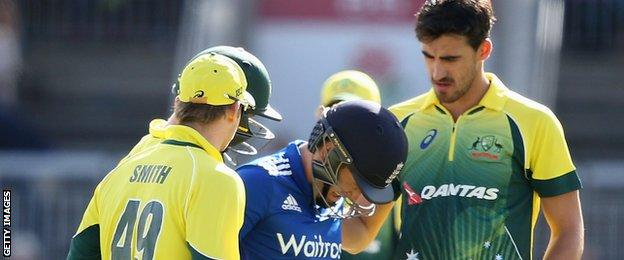 Australia's fielders show concern after Eoin Morgan is hit