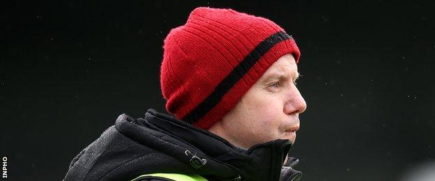Down manager Eamonn Burns shows his frustration during the Mourne County's latest defeat by Roscommon