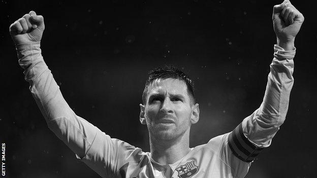 Lionel Messi with his hands in the air