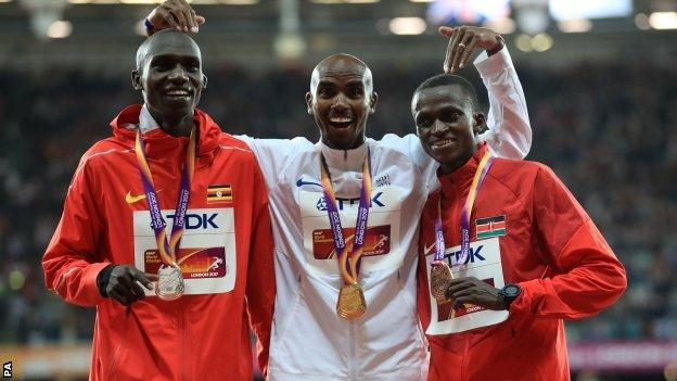 Farah received his medal shortly after edging out Cheptegei (left) by less than a second, with Tanui third