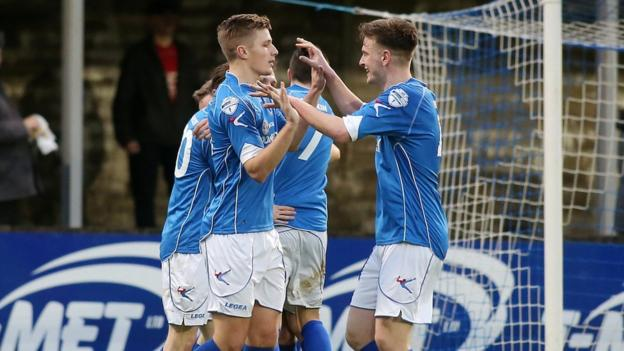 Dungannon players celebrate after Ryan Harpur scores the second of their goals in a 3-1 win over Portadown