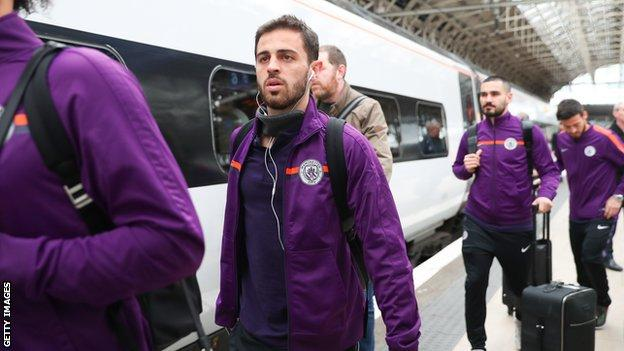 The Manchester City squad take the train from London back to Manchester