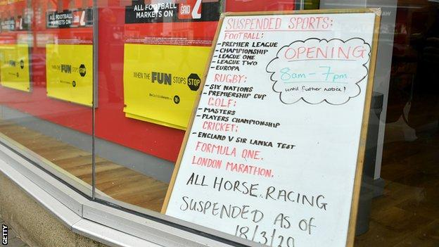 Suspended sport in a betting shop window