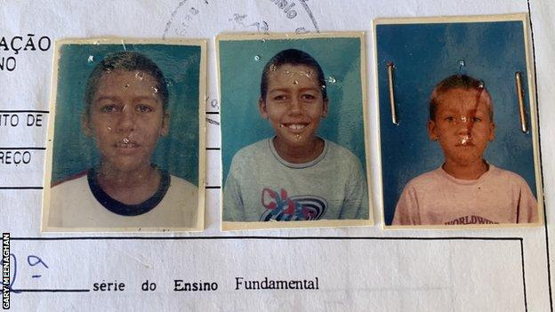 Firmino's school registration form with three photos of him as a child