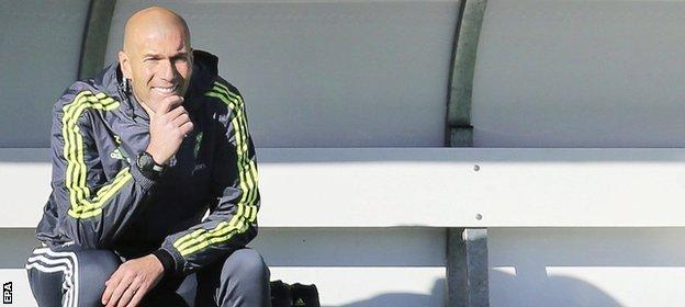 Zidane watches on from the dugout