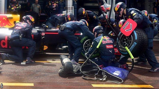 Red Bull work on Daniel Ricciardo's car during the Monaco GP