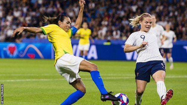Brazil's Marta challenges with France's Eugenie Le Sommer