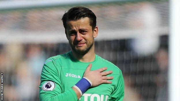 Lukasz Fabianski shows his emotions as Swansea are relegated from the Premier League
