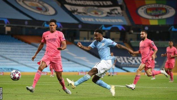 Raheem Sterling has a shot during Manchester City's Champions League game with Real Madrid