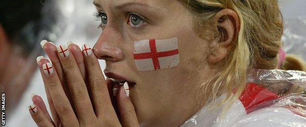 An England fan holds her head in her hands