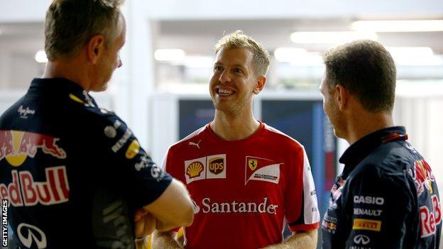 Ferrari driver Sebastian Vettel (centre) speaking to Red Bull chief Christian Horner (right) and team manager Jonathan Wheatley