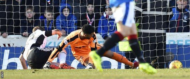 Ayr's Alan Forrest deflects the ball past Rangers' Wes Foderingham