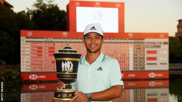 Xander Schauffele holds the WGC-HSBC Champions trophy
