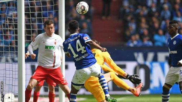 Schalke's Rabbi Matondo shoots at goal during the the Bundesliga match against Augsburg