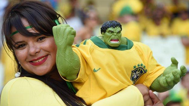 Brazil fan with hulk sculpture