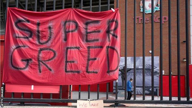 Banners protesting against the European Super League outside Anfield