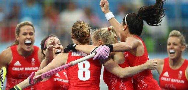 Great Britain celebrate one of Helen Richardson-Walsh's goals in the 3-2 win over Argentina