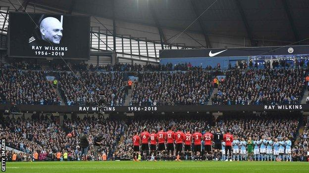 Players and fans of Manchester United, one of Ray Wilkins' former clubs, and Manchester City paid tribute with a minute's applause before the Manchester derby
