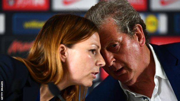 Roy Hodgson with Amanda Doherty, the Football Association's director of communications, at a news conference after the defeat by Iceland