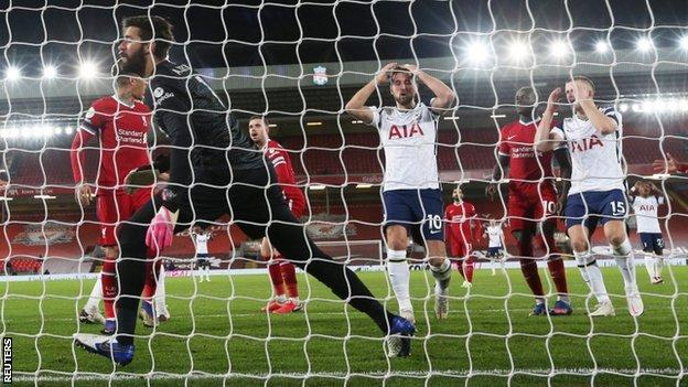Harry Kane puts his hands on his head after missing a chance at Liverpool