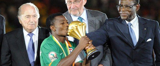 Chris Katongo prepares to lift the Africa Cup of Nations trophy for Zambia in 2012