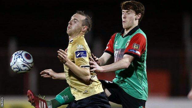 Glentoran's Willie Garrett battles with Shamrock Rovers' Karl Sheppard in a Setanta Sports Cup quarter-final in 2014