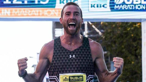 Stephen Scullion shows his delight after crossing the finishing line at the Dublin Marathon last October