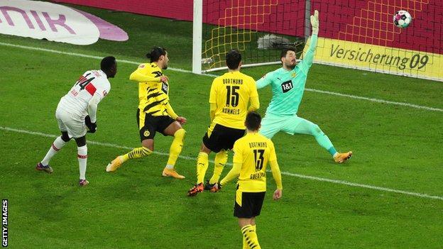 Silas Katompa Mvumpa scores against Borussia Dortmund