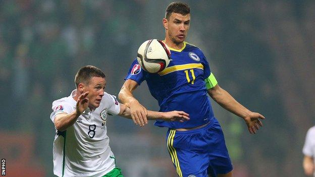 Edin Dzeko battles with James McCarthy in Friday's game in Zenica