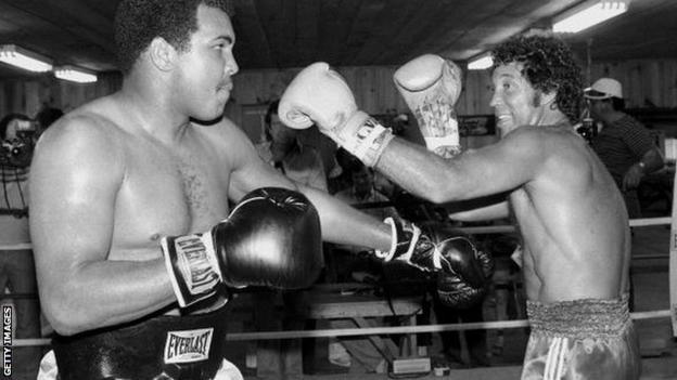 Muhammad Ali spars with Sir Tom Jones