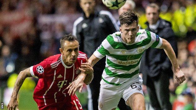Kieran Tierney in action with Bayern Munich's Rafinha