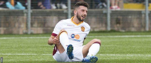 Motherwell's Lee Lucas lies injured against Annan Athletic