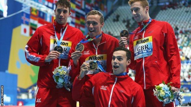 Gold medallists Dan Wallace, Robert Renwick, Calum Jarvis and James Guy of Great Britain pose during the medal ceremony for the Men's 4x200m Freestyle Relay at the World Championships