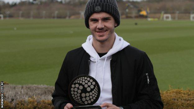 James Maddison shows off his EFL Young Player of the Month trophy