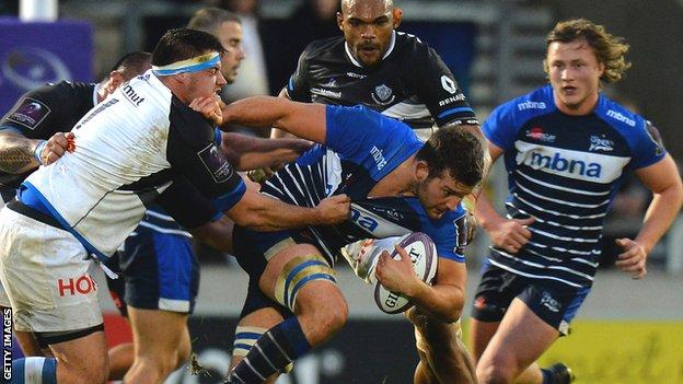 Sales Sharks' Mark Easter breaking through a tackle against Castres
