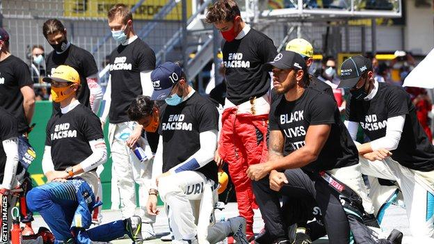 Drivers take the knee and stand during the Austrian Grand Prix